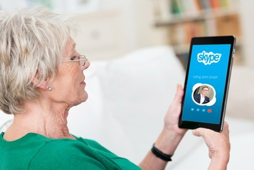 Senior citizen Connecting via Skype to family in Long Term Care homes