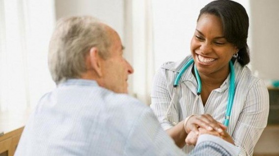 Nurse comforting senior in Long Term Care home protected by WWWorks